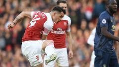Indosport - Gol Granit Xhaka di laga Arsenal vs Manchester United, Senin (11/03/19).