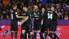 Indosport - Selebrasi pemain Real Madrid di laga kontra Real Valladolid, Senin (11/03/19).