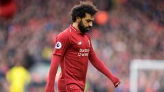 Indosport - Ekspresi rasa kecewa dari pemain bintang Liverpool, Mohamed Salah.