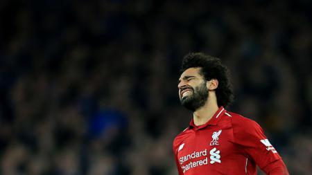 Ekspresi rasa kecewa dari pemain bintang Liverpool, Mohamed Salah. - INDOSPORT