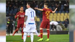 Indosport - Suasana pertandingan AS Roma vs Empoli.