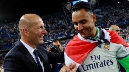 Selebrasi Zinedine Zidane (kiri) dan Keylor Navas (kanan) - INDOSPORT