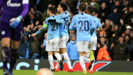 Selebrasi pemain Manchester City usai mencetak gol - INDOSPORT
