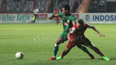 Situasi pertandingan PSS Sleman vs Persija Jakarta - INDOSPORT