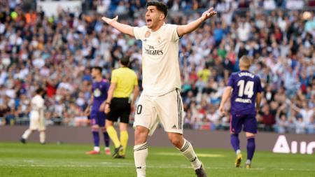 Real Madrid baru saja menjadi kampiun LaLiga Spanyol setelah Marco Asensio membawa mereka unggul atas Leganes dalam suatu turnamen FIFA 20. - INDOSPORT