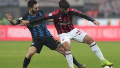 Indosport - Pertandingan yang disebut Derby della Madonnina antara AC Milan vs Inter Milan akan menampilkan perbedaan mencolok kedua tim raksasa Serie A Italia tersebut. Getty Images/Emilio Andreoli.