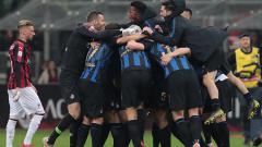 Indosport - Pemain Inter Milan berselebrasi merayakan kemenangan atas AC Milan.