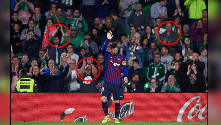Pemain megabintang Barcelona, Lionel Messi mendapat standing applause dari fans Real Betis. Copyright: INDOSPORT
