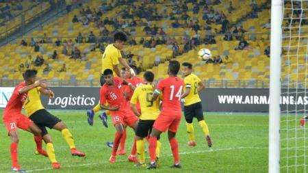 Pemain Malaysia saat berhadapan dengan Singapura di Ajang Marine Cup - INDOSPORT