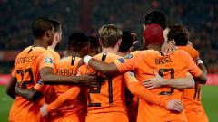 Indosport - Pemain Belanda Merayakan gol Dephay