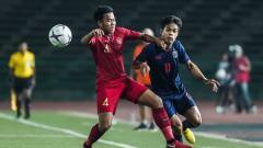 Indosport - Nurhidayat Haji Haris saat melawan Thailand pada laga Piala AFF U22 2019
