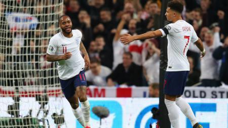 Selebrasi Raheem Sterling usai cetak gol. - INDOSPORT
