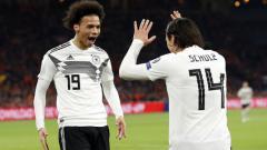 Indosport - Selebrasi Leroy Sane dan Nico Schulz.