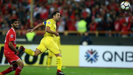 Xavi Hernandez saat membela klub Al Sadd. - INDOSPORT