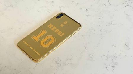 Ponsel Lionel Messi dilapisi emas murni 24 karat. - INDOSPORT