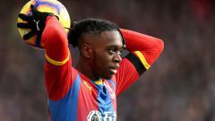 Indosport - Aaron Wan-Bissaka, bek kanan Crystal Palace, tengah diincar oleh Manchester United. Paul Harding/PA Images via Getty Images.