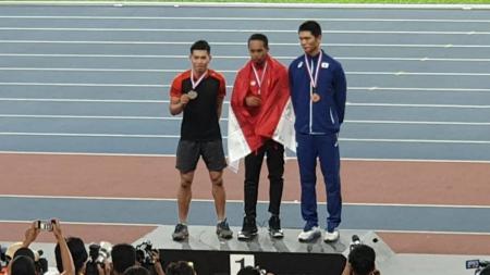 Sapwaturahman berhasil meraih medali emas lompat jauh di ajang 1st Malaysian Grand Prix 2019. - INDOSPORT