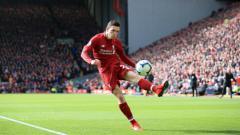 Indosport - Andrew Robertson terpeleset pada laga Liverpool vs Chelsea, Minggu (14/04/19) malam.
