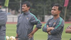 Indosport - Guntur Cahyo (kanan) saat bersama Timnas Indonesia U-19 tahun lalu.