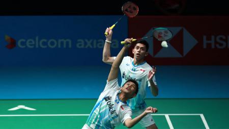Fajar Alfian/Muhammad Rian Ardianto saat melawan Kevin Sanjaya Sukamuljo/Marcus Fernaldi Gideon di Malaysia Open 2019, Jumat (05/03/19). - INDOSPORT
