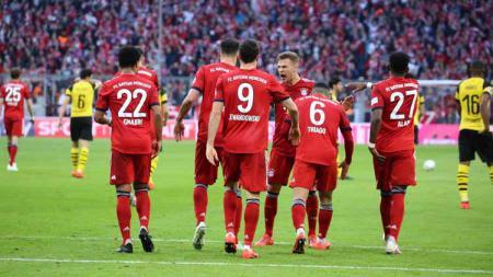 Momen para pemain merayakan gol pada pertandingan Bayern Munchen vs Borussia Dortmund di Bundesliga Jerman, Sabtu (6/4/19). - INDOSPORT