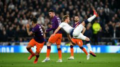 Indosport - Upaya Harry Kane untuk membobol gawang Manchester City.