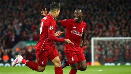 Pemain sepak bola Liverpool yang bernama Naby Keita (kanan) diperkirakan bakal dengan mudah untuk pindah ke raksasa Serie A Liga Italia, AC Milan, berkat Mino Raiola. - INDOSPORT