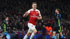 Indosport - Selebrasi Aaron Ramsey usai membobol gawang Napoli pada babak 8 besar Liga Europa 2019, Jumat (12/04/19), di Stadion Emirates.