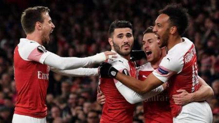 Pemain Arsenal merayakan gol ke gawang Napoli pada babak 8 besar Liga Europa, Jumat (12/04/19), di Stadion Emirates. - INDOSPORT