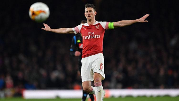 Laurent Koscielny saat pertandingan leg pertama perempatfinal antara Arsenal vs Napoli di Stadion Emirates, Jumat (12/04/19) dini hari WIB Copyright: BEN STANSALL/AFP/Getty Images