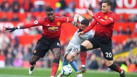 AC Milan mengajukan tawaran sebesar 17 juta euro (Rp280 miliar) untuk mempermanenkan bek serbabisa Diolo Dalot dari Manchester United. - INDOSPORT