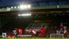 Indosport - Keberhasilan Liverpool meraih trofi Liga Champions membuat Jurgen Klopp menarik larangan menyentuh banner ikonik 'This Is Anfield' di Stadion Anfield.