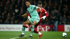 Indosport - Pierre-Emerick Aubameyang cetak gol ke gawang Watford, Selasa (16/04/19), di Vicarage Road.