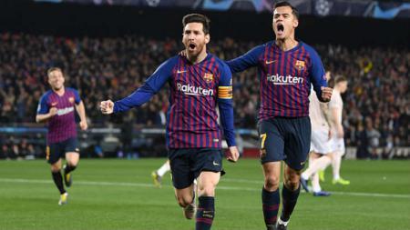 Selebrasi Lionel Messi usai cetak gol ke gawang Manchester United. - INDOSPORT