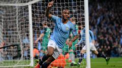 Indosport - Selebrasi Raheem Sterling usai cetak dua gol ke gawang Tottenham Hotspur.