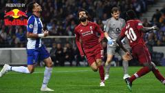 Indosport - Ekspresi Mohamed Salah usai mencetak gol ke gawang FC Porto. Foto: PAUL ELLIS/AFP/Getty Images