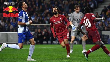 Ekspresi Mohamed Salah usai mencetak gol ke gawang FC Porto. Foto: PAUL ELLIS/AFP/Getty Images - INDOSPORT