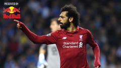 Indosport - Pemain Liverpool, Mohamed Salah dari usai mencetak gol kedua untuk timnya ke gawang Porto. Foto: Matthias Hangst/Getty Images