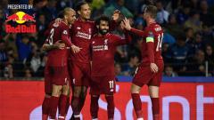 Indosport - Skuat Liverpool merayakan gol ke gawang Porto di perempatfinal Liga Champions.