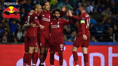 Skuat Liverpool merayakan gol ke gawang Porto di perempatfinal Liga Champions. - INDOSPORT