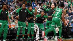 Indosport - Selebrasi para pemain Boston Celtics dalam sebuah petandingan.