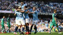 Indosport - Selebrasi Phil Foden setelah mencetak gol pada laga Liga Primer Inggris antara Manchester City dan Tottenham Hotspur (20/04/2019).