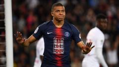 Indosport - Pemain Paris Saint-Germain (PSG), Kylian Mbappe, punya rekan senegara yang diminati klub-klub besar Liga Primer Inggris. FRANCK FIFE/AFP/Getty Images.