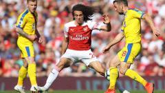 Indosport - Pemain Arsenal, Matteo Guendouzi tidak terlihat ketika timnya sedang berpesta usai merengkuh gelar juara Piala FA.