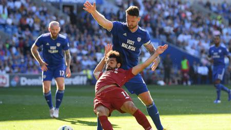 Mohamed Salah terjatuh ketika melawan Cardiff City - INDOSPORT