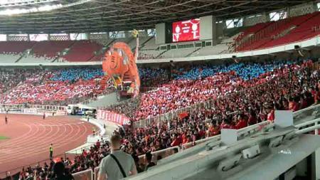 Ilustrasi koreografi The Jakmania saat mendukung Persija Jakarta. Zainal Hasan/INDOSPORT - INDOSPORT