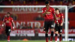 Indosport - Marcus Rashford tertunduk lesu usai gawang timnya kebobolan pada laga Liga Primer Inggris di Old Trafford pada 24 April 2019. Shaun Botterill/Getty Images