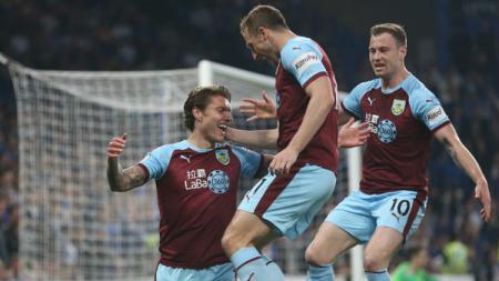 FC Burnley yang saat ini menghuni papan tengah kompetisi kasta teratas Liga Inggris, terancam mengalami kerugian besar jika tak menyelesaikan musim ini. - INDOSPORT
