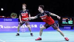 Indosport - Kevin Sanjaya/Marcus Gideon saat kalah di final Badminton Asia Championships 2019.