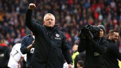 Indosport - Pelatih tim promosi, Sheffiled United, Chris Wilder, meminta Liga Inggris diteruskan dan diselesaikan dengan sempurna.